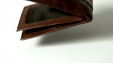 Brown leather wallet falling — Vídeo de stock