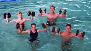 Fit people doing an aqua aerobics class — Stock Video