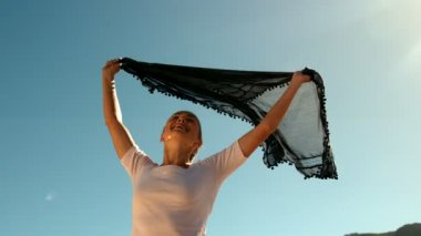 Happy woman holding black scarf — Stockvideo