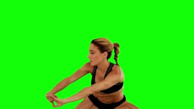 Super fit woman doing sumo squats — Wideo stockowe
