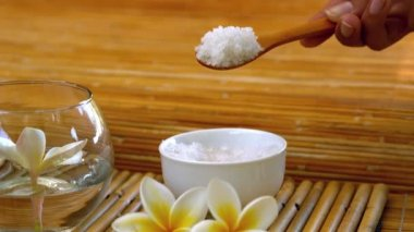 Salt scrub pouring into bowl at the spa — 图库视频影像