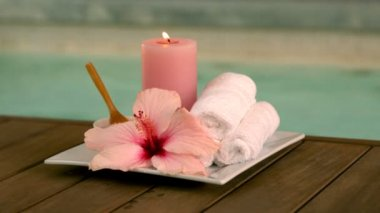 Beauty treatments and candle poolside with lily — Stock Video