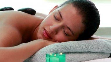 Calm brunette getting hot stone massage — Stock Video