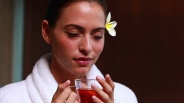 Content brunette drinking herbal tea — Stock Video