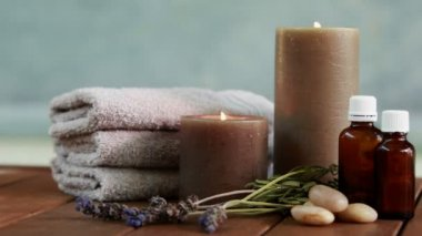 Towels candles and dried lavender by the pool — 图库视频影像