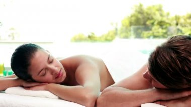 Peaceful couple getting hot stone massages — Stock Video