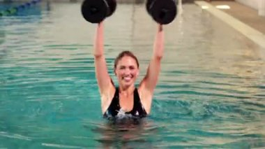 Fit woman doing aqua aerobics — Stock Video
