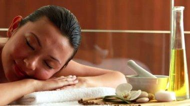 Gorgeous brunette lying on massage table — Stock Video