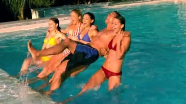 Friends jumping back into swimming pool together — Stock Video
