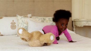 Baby girl with teddy bear — Stok video