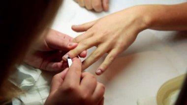 Nail technician removing cuticles — Stock Video