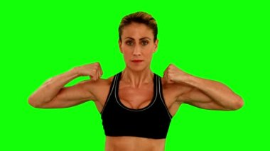 Super fit woman flexing her arms — Stok video