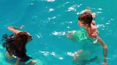 Happy couple having fun in the pool — Stock Video
