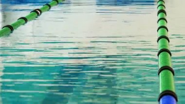Swimming pool moving with lane markers — Vídeo Stock
