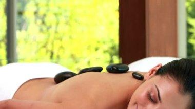 Relaxed friends enjoying hot stone massages — Stock Video