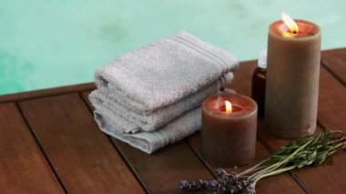 Towels candles and dried lavender by the pool — Stock Video