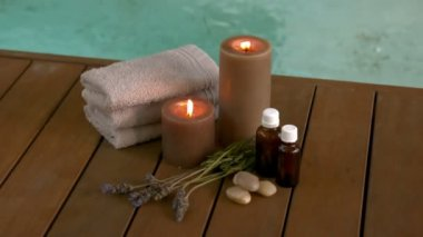 Beauty treatments and candles poolside — Stock Video