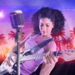 Girl playing guitar — Stock Photo #49984545