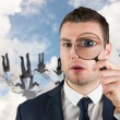 Businessman looking through magnifying glass — Stock Photo #49985065