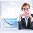 Redhead businesswoman sitting at desk — Stock Photo #49986499
