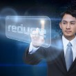 Businessman pointing to word reduce — Stock Photo #49988121
