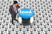 Load against blue push button — Stockfoto