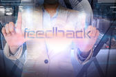Businesswoman presenting the word feedback — Stock Photo