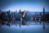Businessman doing balancing act on tightrope — Stock Photo