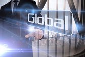 Businessman presenting the word global — Stock Photo
