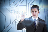 Businessman pointing to word threats — Stock Photo