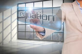 Businesswoman pointing to word equation — Stock Photo