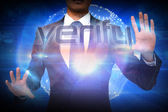 Businessman presenting the word verify — Foto Stock