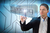 Businessman pointing to word planning — Stock Photo