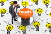 Reach against orange push button — Stockfoto