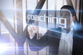 Businessman presenting the word coaching — Stock Photo