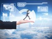 Businessman jumping holding an umbrella — Stock Photo