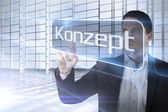 Businessman presenting the word concept in german — Stock Photo