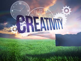 Businesswomans hand presenting the word creativity — Stock Photo