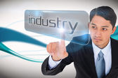 Businessman pointing to word industry — Foto de Stock