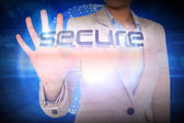 Businesswoman presenting the word secure — Stock Photo