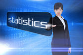 Businesswoman pointing to word statistics — Stock Photo