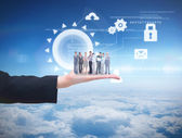 Business team against blue sky — Foto Stock