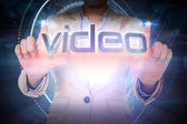 Businesswoman presenting the word video — Stock Photo