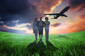 Businesswomen looking at camera with airplane — Stock Photo