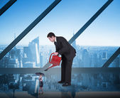 Businessman watering tiny businesswoman — Stock Photo
