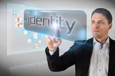 Businessman pointing to word identity — Stock Photo