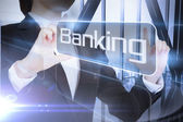 Businessman presenting the word banking — Stock Photo