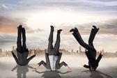 Businessmen burying their heads — Stock Photo
