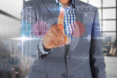 Businessman touching the word tools on interface — Stock Photo