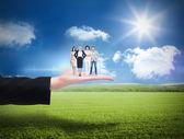 Business team against sunny green landscape — Stockfoto